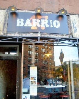 The Outside Logo is Simple and Clean, BARRIO is Spanish for Neighborhood.